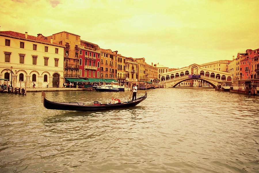 Gondola In A Canal, Rialto Bridge Photograph by Medioimages/photodisc