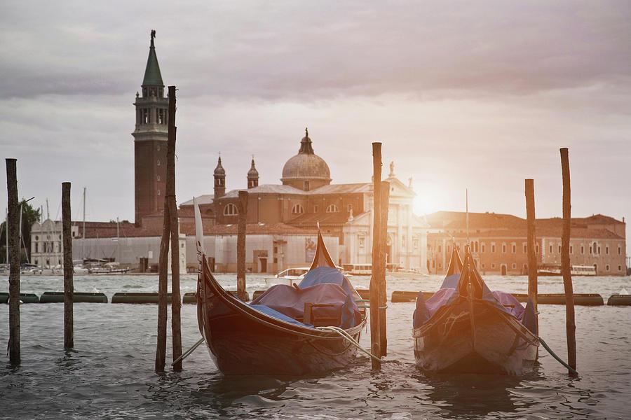 Gondolas Docked On Urban Canal Photograph by Walter Zerla