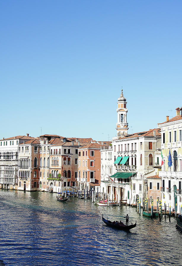 Gondolier On Venice Canal Photograph by Stuart Paton