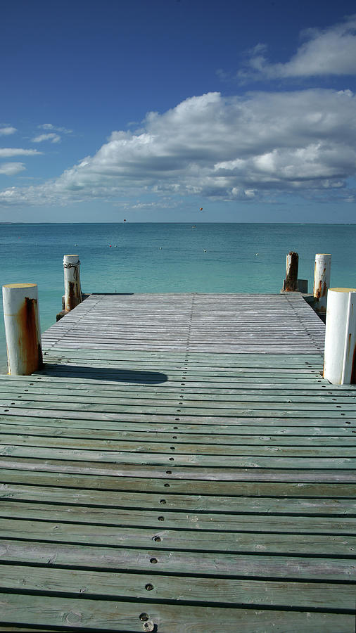Scenic Photograph - Grace Bay Wooden Pier On The Island Of by Greg Newington
