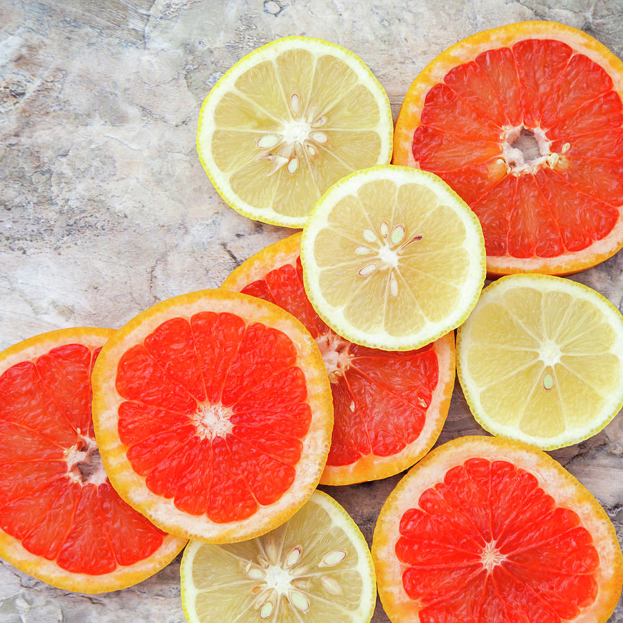 Grapefruit And Lemon Photograph by Flavia Morlachetti
