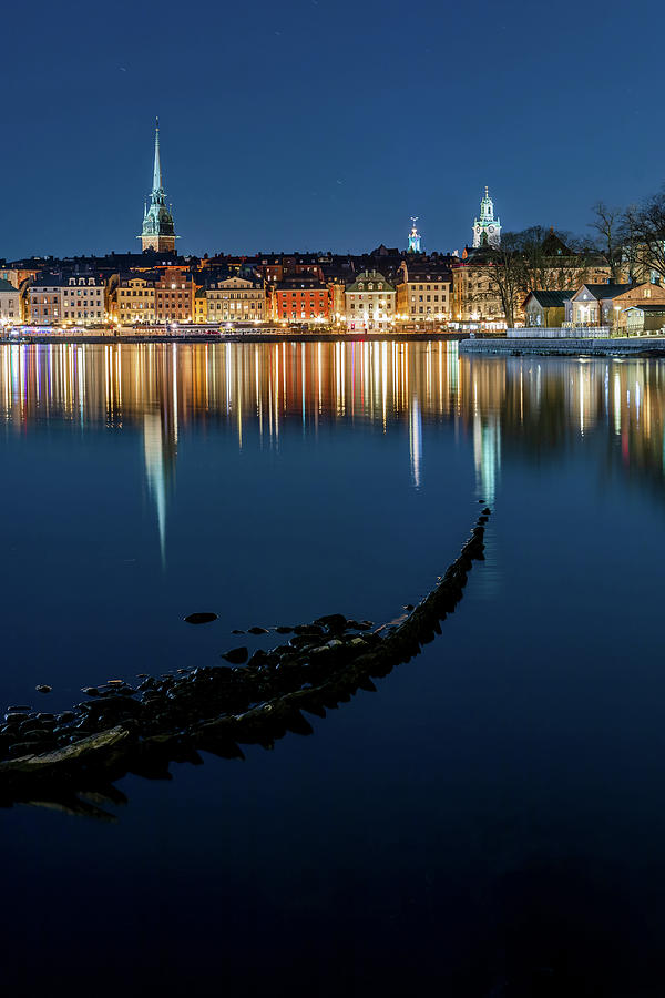 Gray Wolf Shipwreck and Stockholm Gamla Stan fantastic reflection in the Baltic Sea  by Dejan Kostic