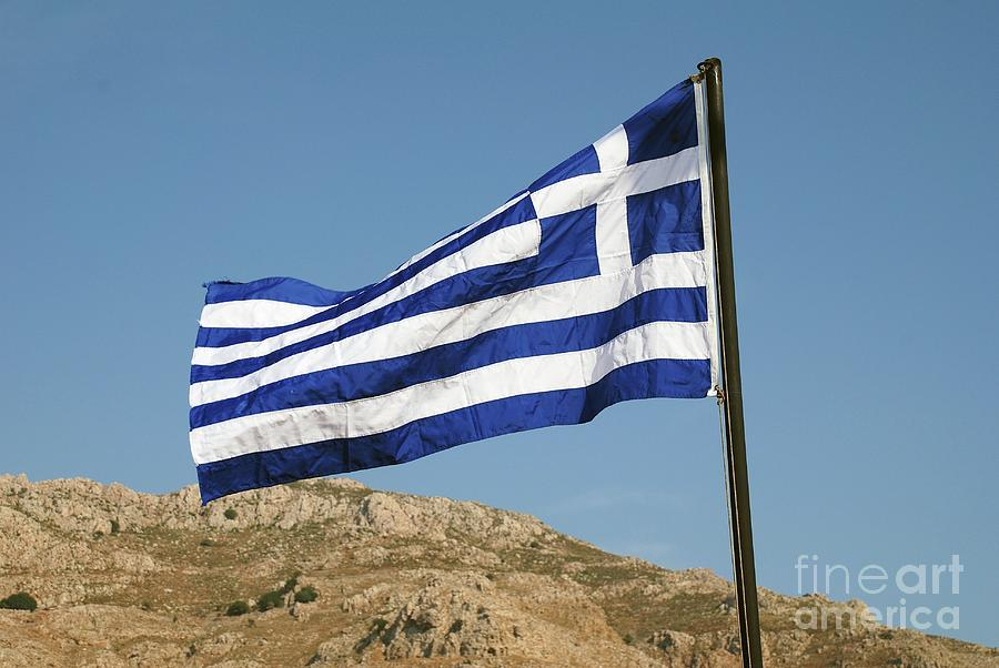 Greek flag on Tilos island by David Fowler