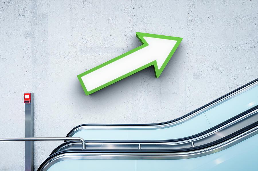 Green Arrow And Escalator Photograph by Jorg Greuel
