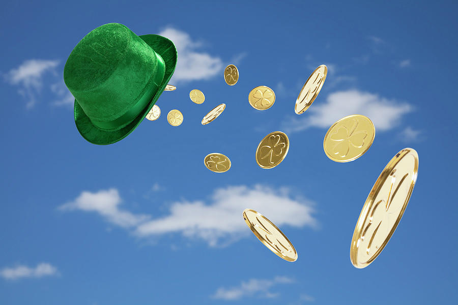Green Hat Sweeping Gold Coins Photograph by Vstock Llc