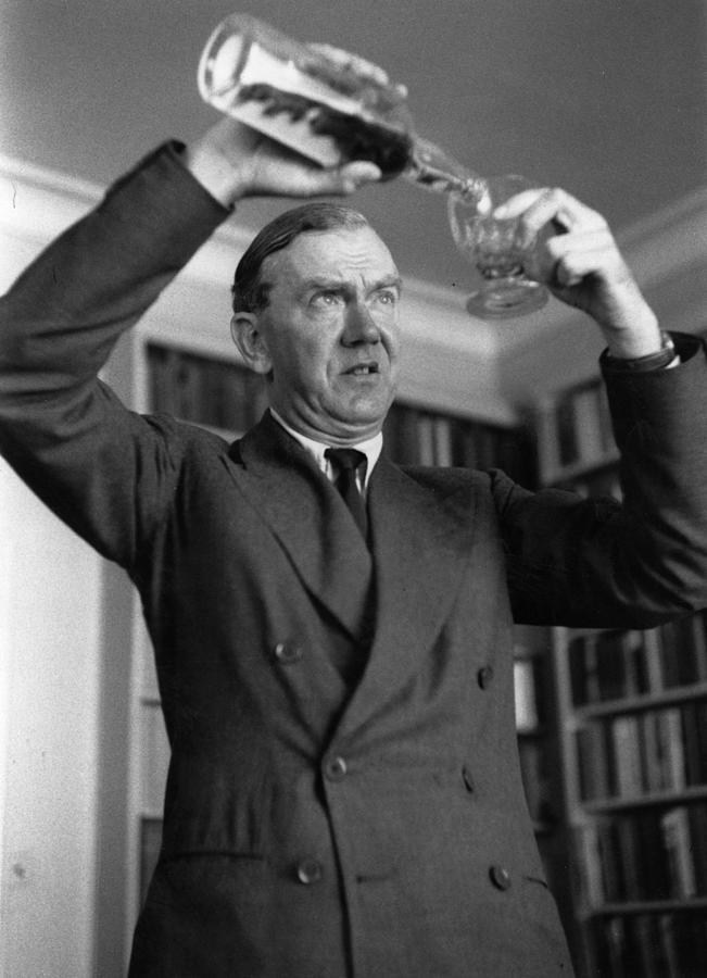 Greene Pours Drink Photograph by Kurt Hutton