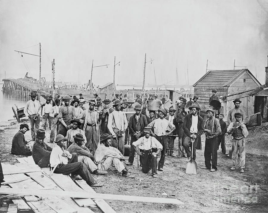 Group Of Freed Slaves Along Harbor Photograph by Bettmann