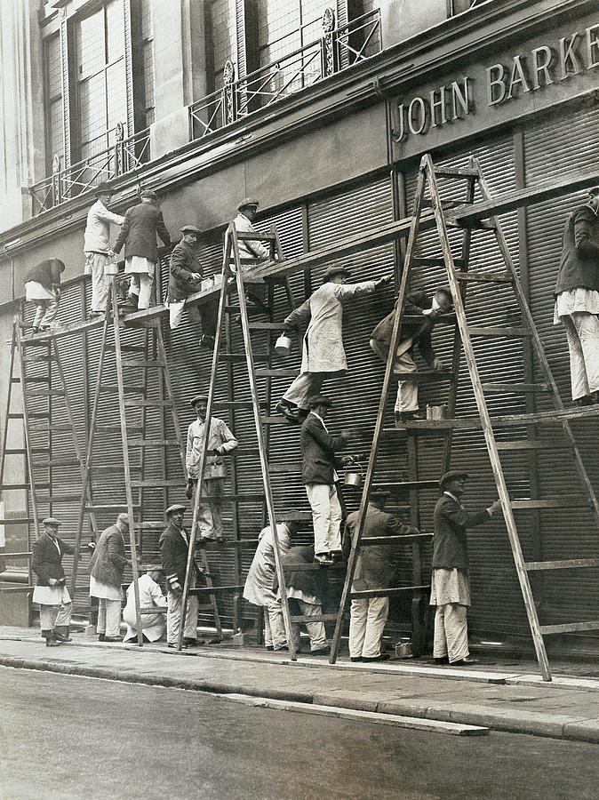 Group Of Painters On Ladders Photograph by Digital Vision.