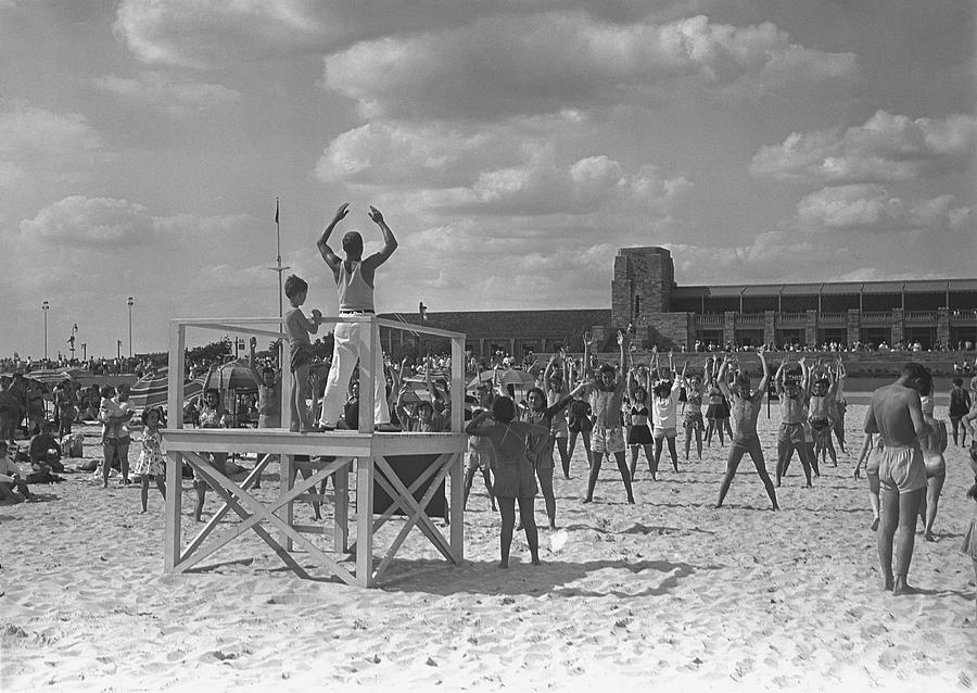 Group Of People Exercising On Beach, B&w Photograph by George Marks