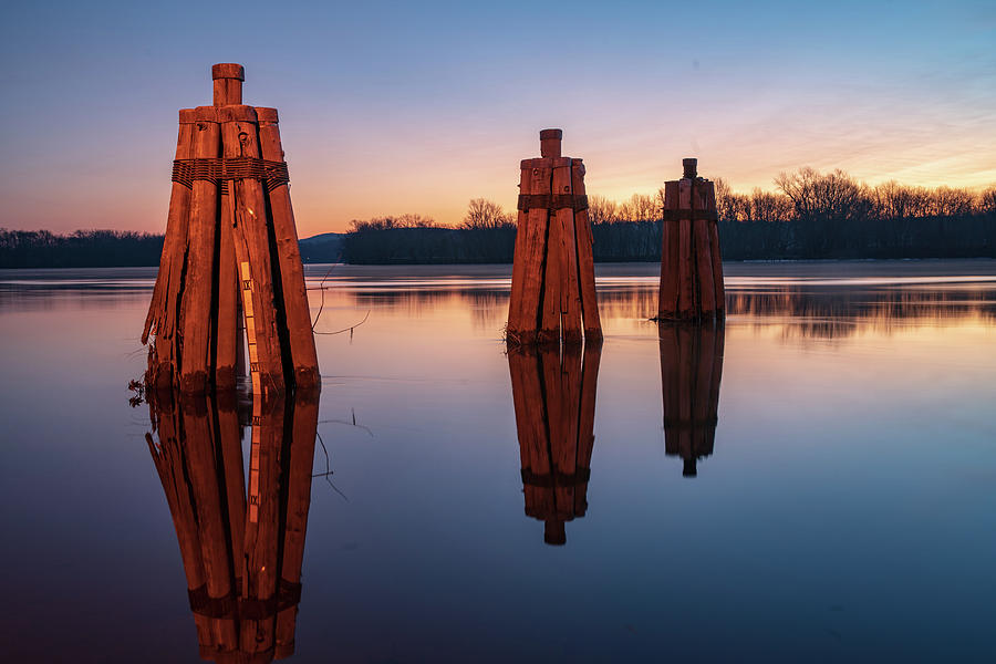 Group of three docking piles on Connecticut river by Kyle Lee