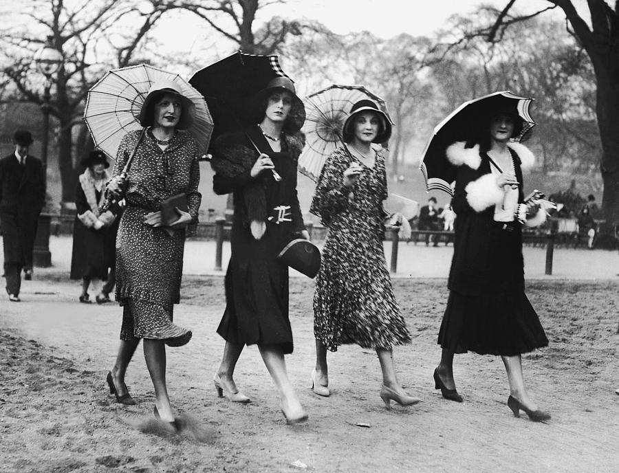 Group Of Women Walking With Umbrellas Photograph by Fpg