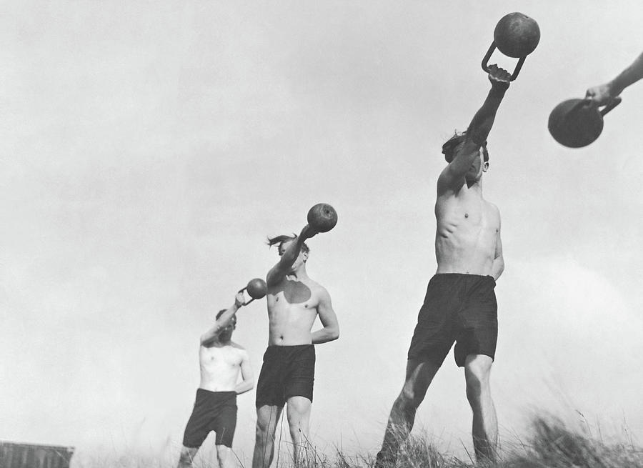 Group Of Young Men Exercising Outdoors Photograph by Fpg