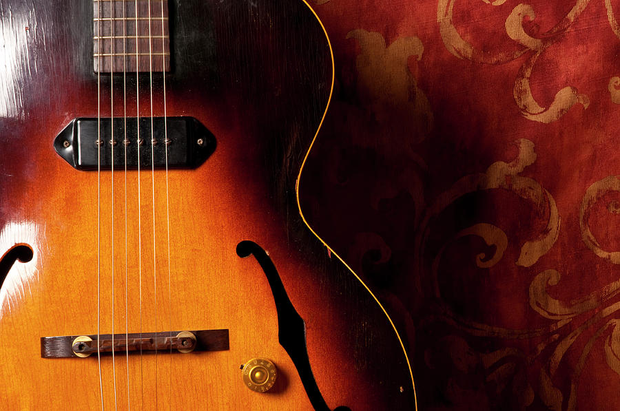 Guitar With Red Background Photograph by Bns124