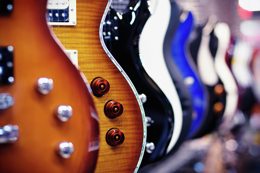 Guitars In A Shop Photograph by Alexrodavlas