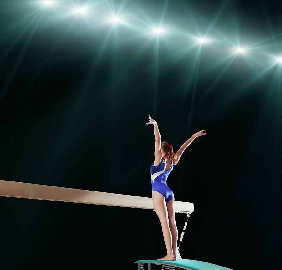 Gymnast Competing On Balance Beam Photograph by Robert Decelis Ltd