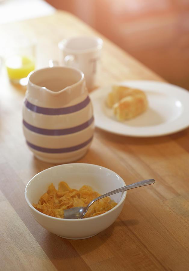 Half Eaten Breakfast On Kitchen Table Photograph by Dougal Waters
