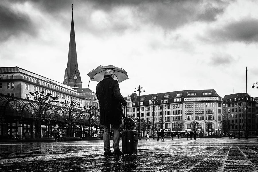 Hamburg Photograph - Hamburg - man with umbrella and suitcase by Ute Herzog