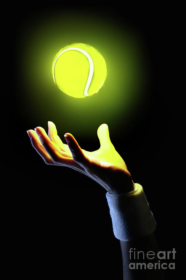 Hand Of Tennis Player Holding Glowing Photograph by Stanislaw Pytel