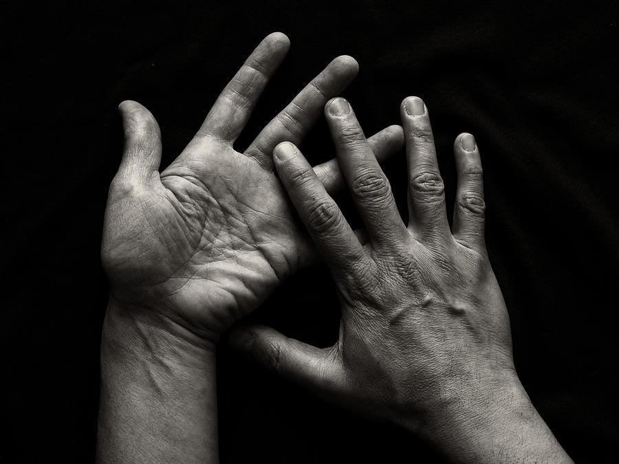 Hands On Black Background Photograph by Luigi Masella