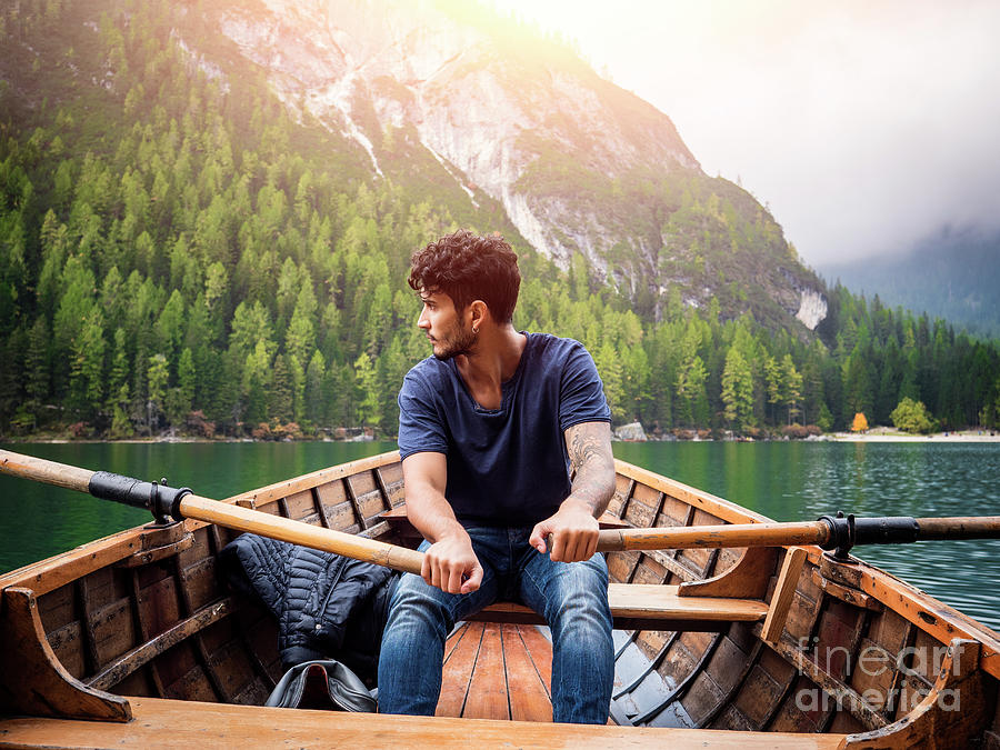 Handsome Man Rowing In Boat Photograph
