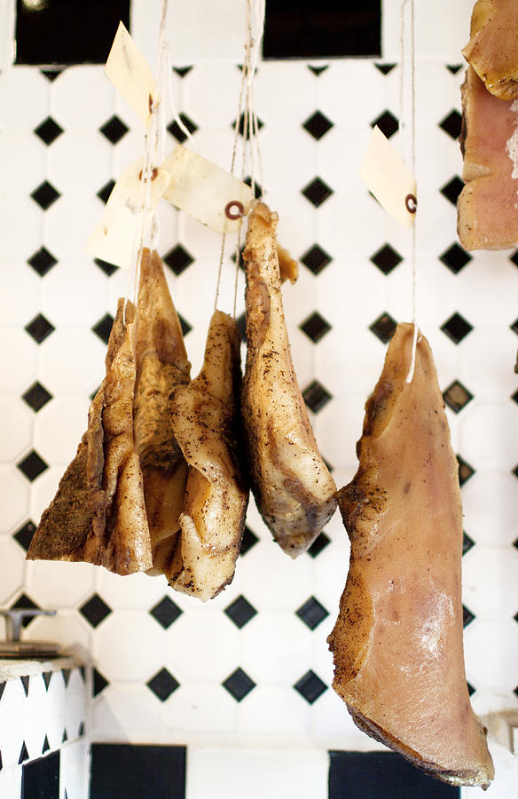 Hanging Cured Pig At La Boucherie Photograph by Charity Burggraaf