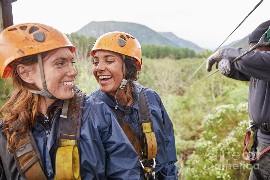 Adventure Photograph - Happy Women Friends Zip Lining by Caia Image/science Photo Library