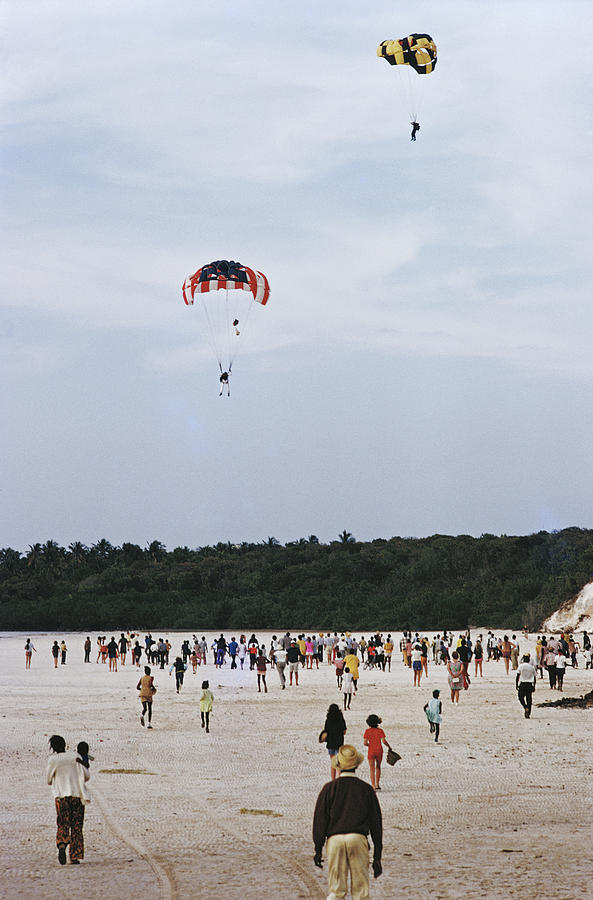 Harbour Isle Parachutists Photograph by Slim Aarons