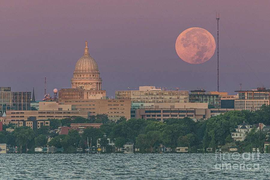Harvest Moon Sets Over City by Jackie Johnson