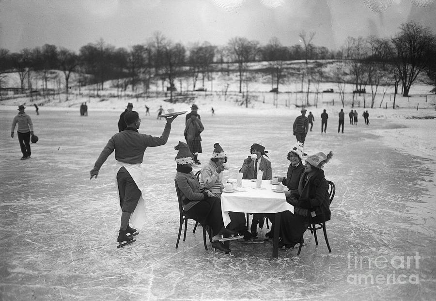 Having Dinner At Table On Ice Rink Photograph by Bettmann