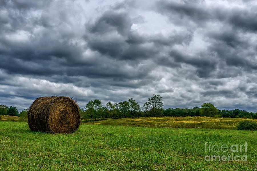 Hay Bale and Stormy Sky by Thomas R Fletcher