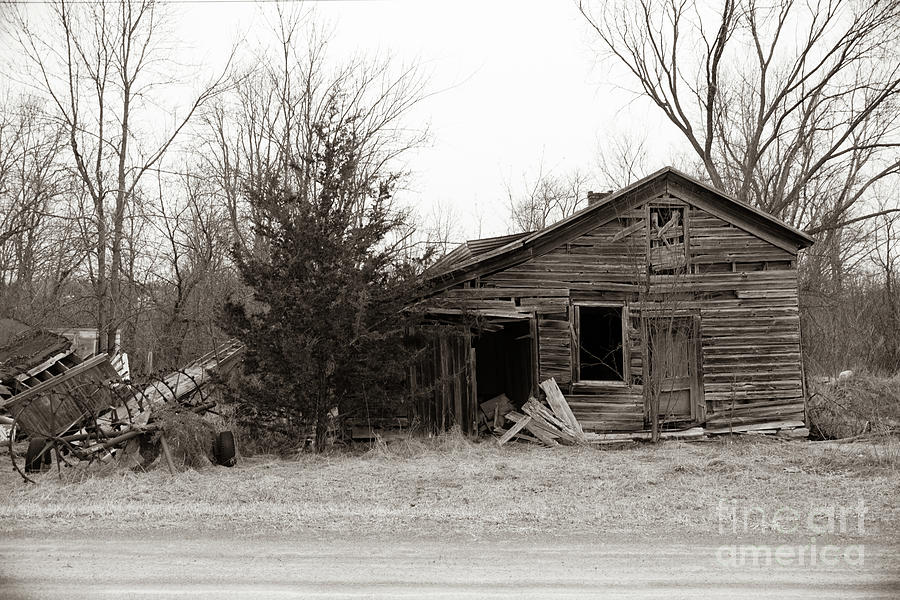 Country Barn Photograph - Hay Barn With Farm Equipment.  Black And White. by John Rowley