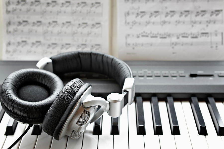 Headphones On Electronic Piano Keyboard Photograph by Wilfried Krecichwost