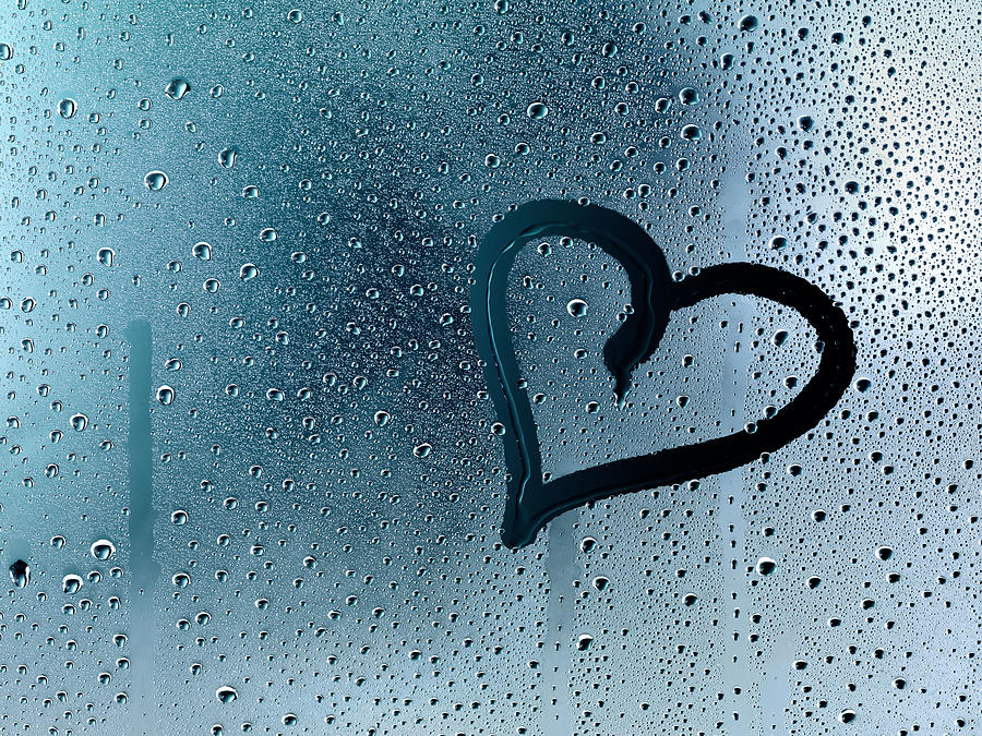Heart At Window Pane With Raindrops Photograph by Stock4b-rf