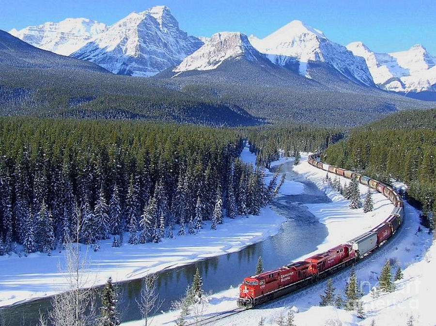 Heavy Train Load Thru The Rockies by Rod Jellison