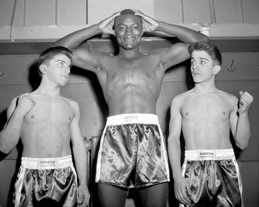 Heavyweight Luke Clark Towers Over The Photograph by New York Daily News Archive