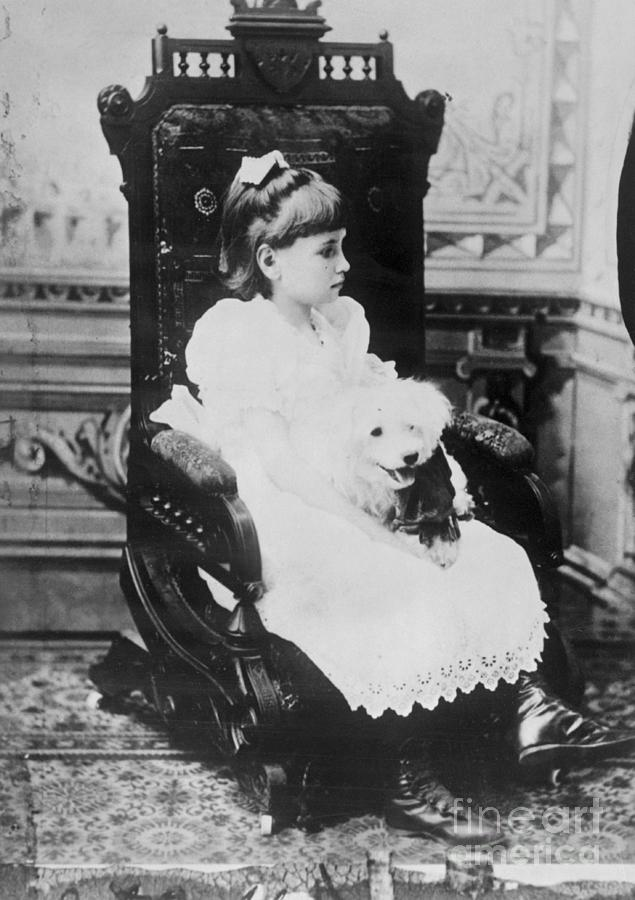 Helen Keller Holding Pet Poodle In Chair Photograph by Bettmann