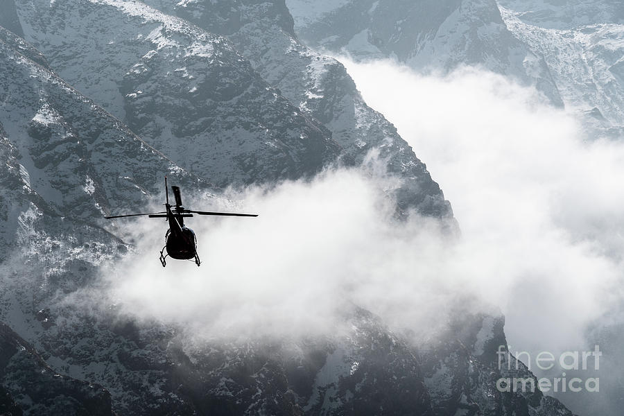 Helicopter flying in the Himalayas in Nepal by Didier Marti