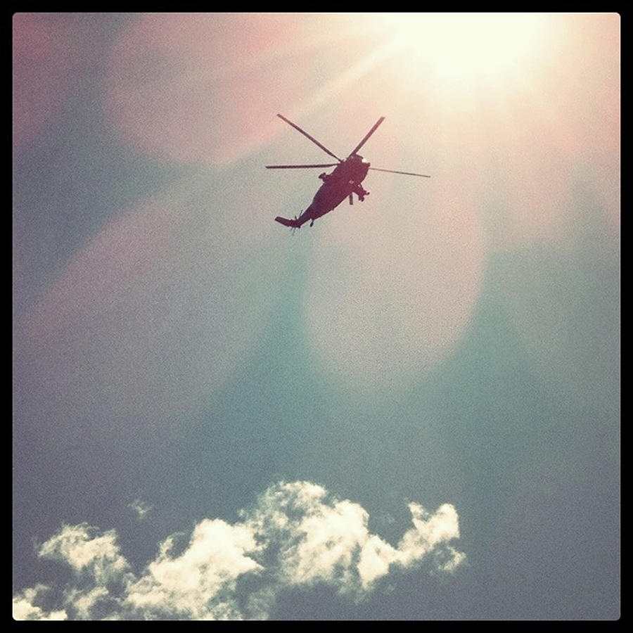 Helicopter Hovering Overhead Photograph by Jill Tindall