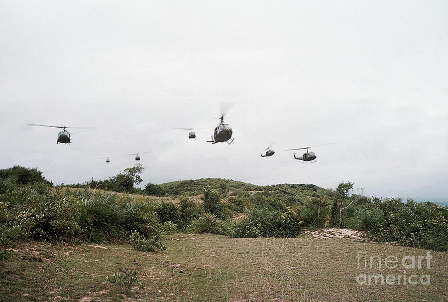 Helicopters Flying In Formation Photograph by Bettmann
