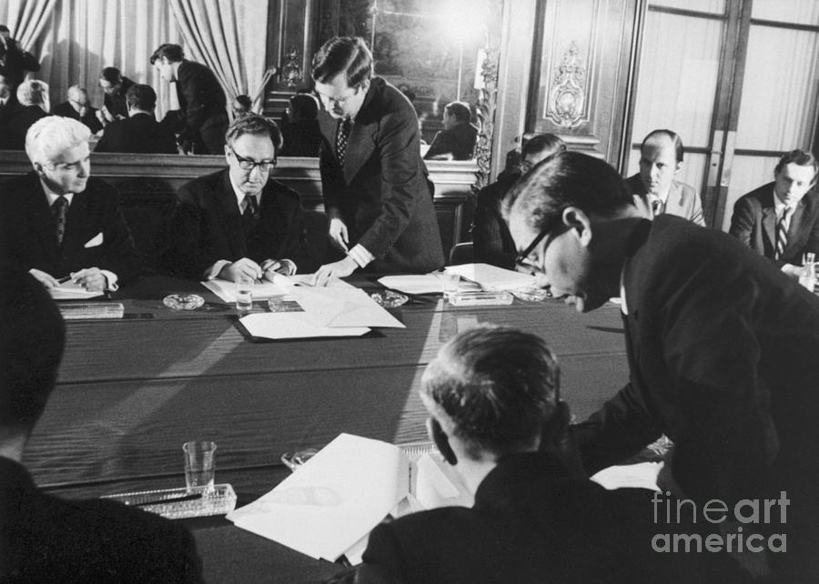 Henry Kissinger Signs Cease Fire Photograph by Bettmann