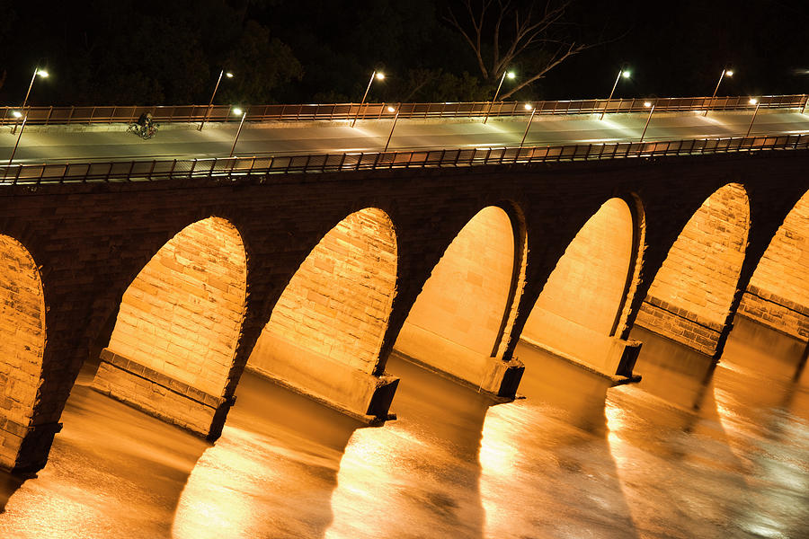 Historic Stone Arch Bridge Over The Photograph by Jimkruger