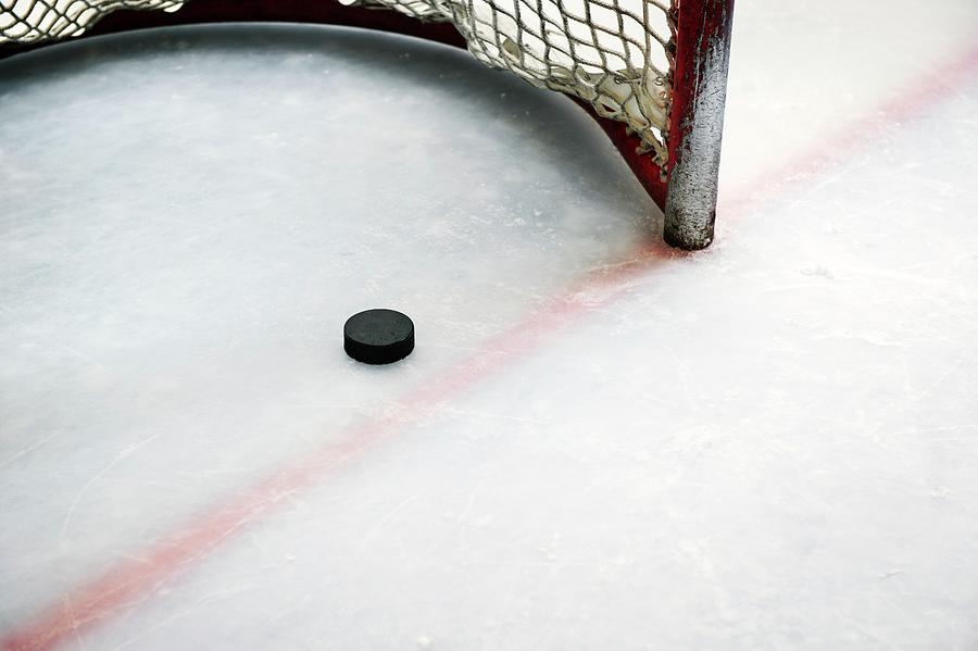 Hockey Puck In Goal And Red Line Photograph by Francisblack