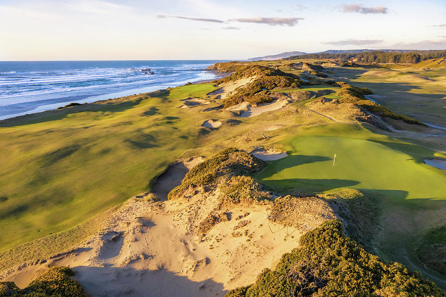 Hole 13 and 14 Pacific Dunes Golf Course by Mike Centioli