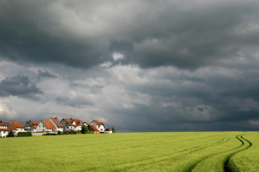 Homes And Grain Field With Winding Tire Photograph by Thomas Winz