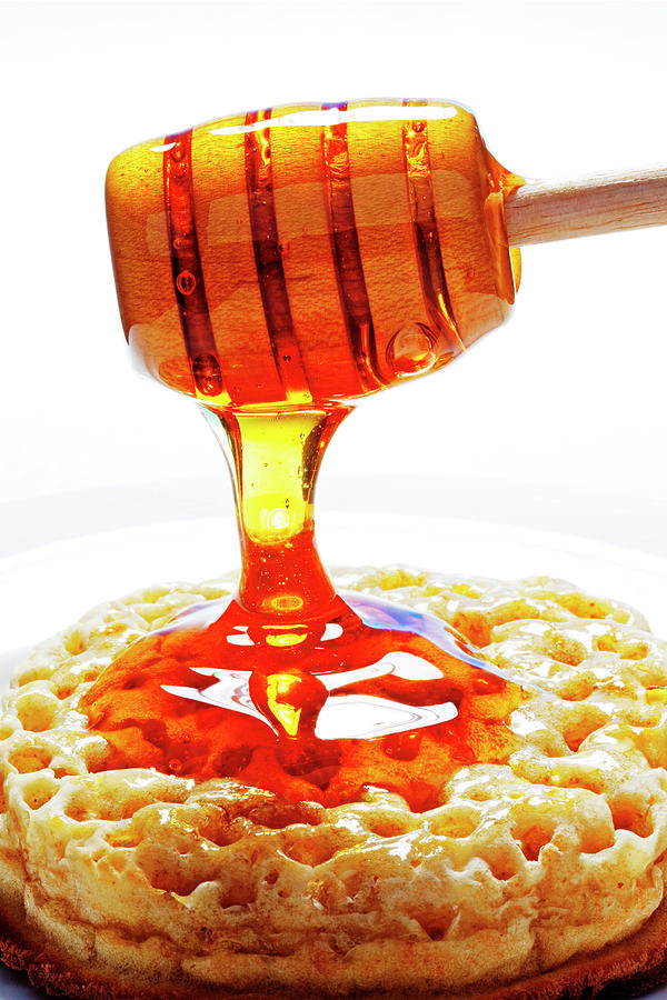 Honey Pouring On  Crumpet Photograph by John W Banagan