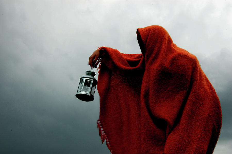 Hooded Crone Holds Lantern In Storm Photograph by Kewaters