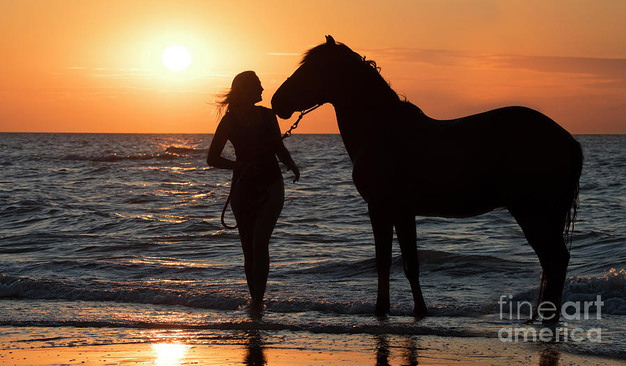 Horse and Woman at Sunset by Arterra Picture Library