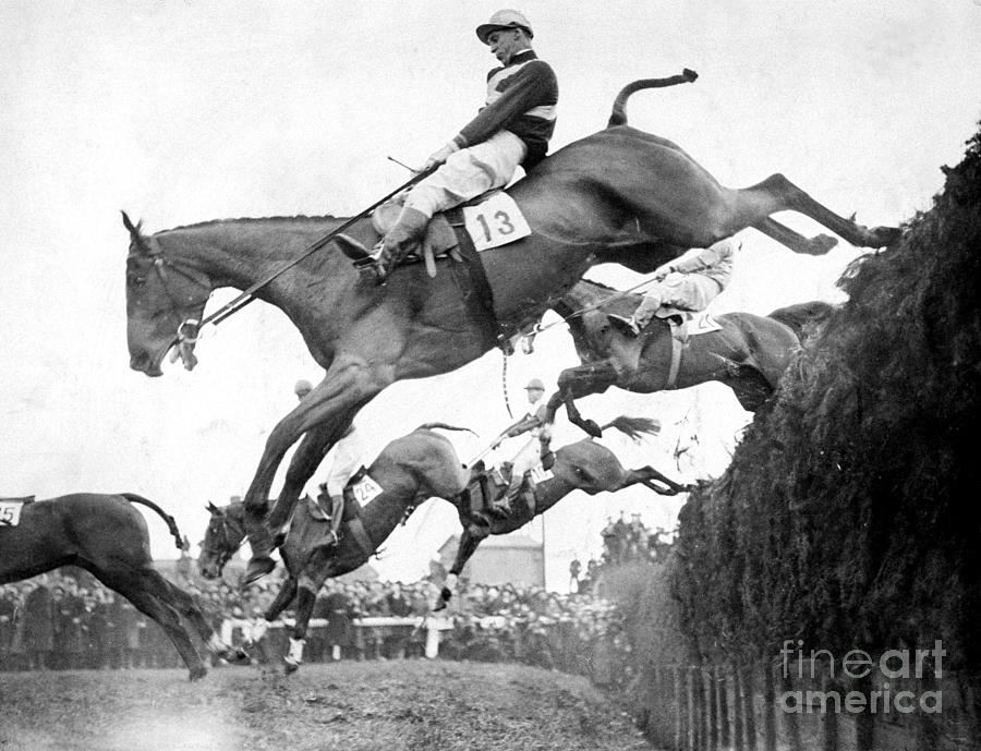 Horses Take Beechers Brook Jump In The Photograph by New York Daily News Archive