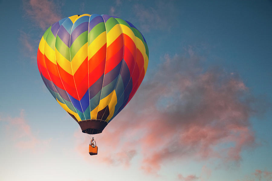 Hot Air Ballon On An Evening Flight Photograph by William Manning