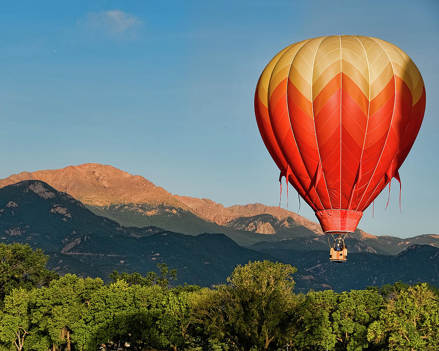 Hot Air Balloon Flies By Pikes Peak Photograph by Christopher Coleman